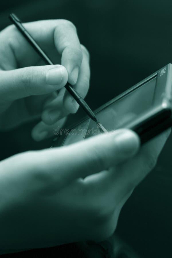 Utilisant PDA photographie stock