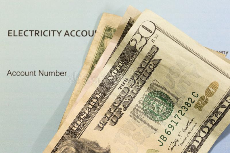 Utility Bill and Money stock photography