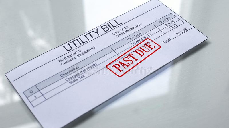 Utility bill past due, seal stamped on document, payment for services, charges. Stock photo royalty free stock image