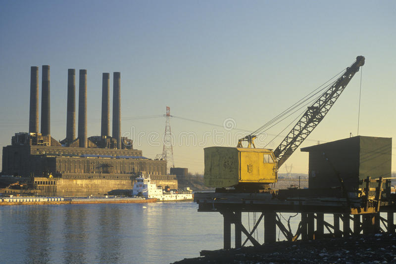 A utility plant and grain barge stock images