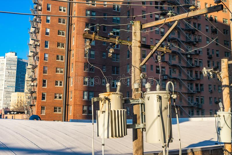Utility Pole in Chicago surrounded by Buildings stock images
