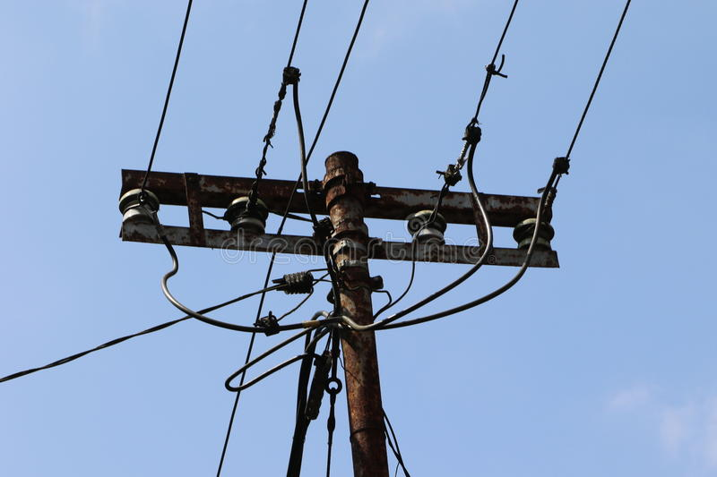 Utility pole. A utility pole is a column or post used to support overhead power lines and various other public utilities, such as cable, fibre optic cable, and stock image