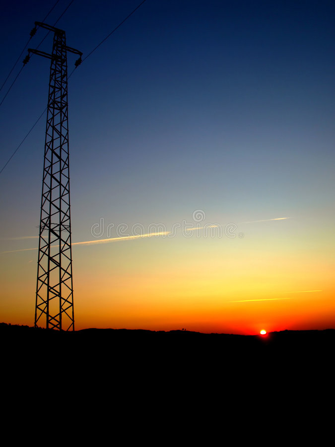 Utility pole in the sunset. A suggestive shot of an utility pole in countryside at the sunset hour stock photos