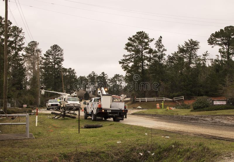 Utility Repair from Tornado on Smith Road. `Utility Repair from Tornado  on Smith Road`, is a photo taken on Smith Road, in Fortson, Georgia royalty free stock photo