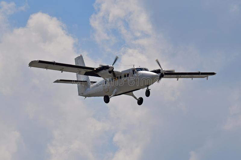 Utility turboprop aircraft. Twin turboprop utility aircraft on blue sky background stock photography