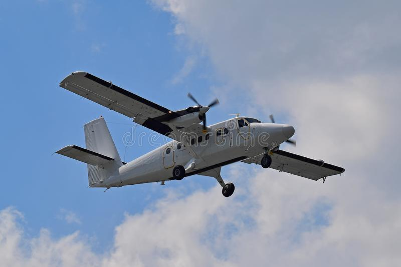 Utility turboprop aircraft. Twin turboprop utility aircraft on blue sky background stock photos