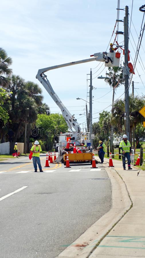 Utility workers in a cherry picker stock images