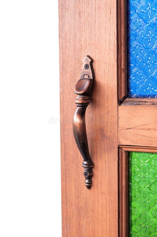 Utilizado para abrir la captura de la puerta, tiradores de puerta colorea el vidrio del vintage, parte de la puerta de madera foto de archivo libre de regalías