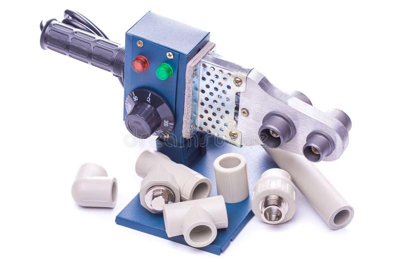 Utilize ferramentas para o isolatedplástico do pipedo weldingem um branco fotografia de stock royalty free