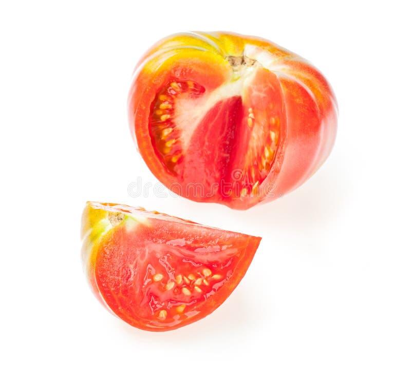 Utklippskiva från den röda saftiga tomaten bakgrund isolerad white royaltyfri fotografi