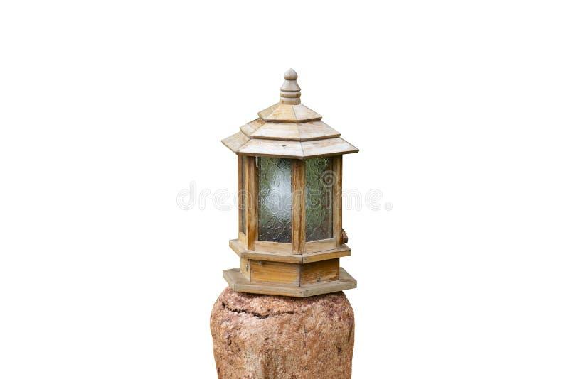 Utomhus- lampa på stenen som är dekorativ i trädgård arkivfoto