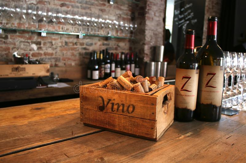 Utrecht, the Netherland , March 10 - 2019: Wine bar setup with wooden corks and two bottles of wine royalty free stock photo