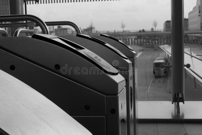 Utrecht, the Netherlands, February 15, 2019: a black and white sideview of checkin gates of NS utrecht central station stock image