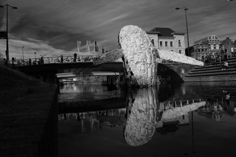 Utrecht, the Netherlands, February 24 - 2019, Whale made of plastic waste in the canal against pollution Black and white stock photos