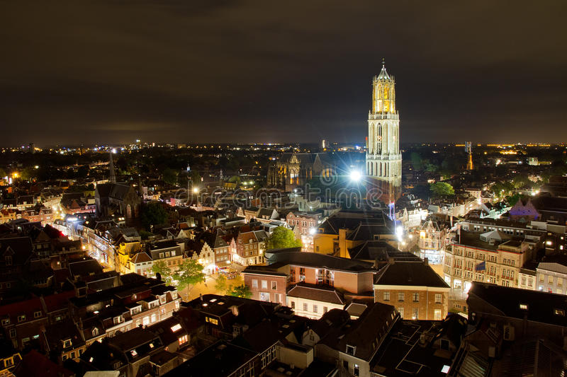 Utrecht skyline. Cityscape of the city of Utrecht at night with the Dom cathedral lit by big lights royalty free stock photo