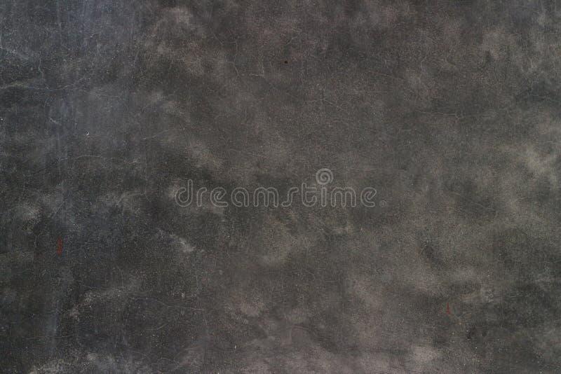 Utrymmemellanrum som är mörkt - grå cementvägg för abstrakt bakgrund royaltyfria foton