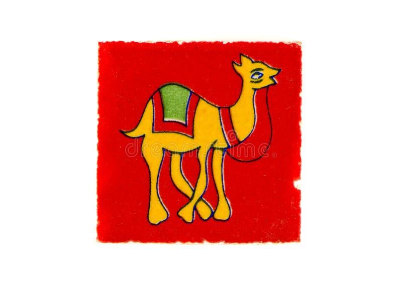 Utsmyckad indisk dekorativ tegelplatta med den isolerade kamelbilden royaltyfria bilder