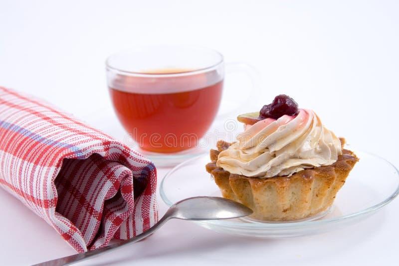 utsmyckad teacup för cake royaltyfri bild