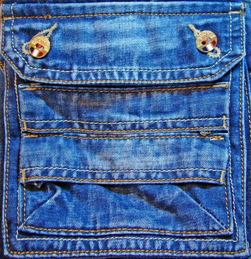 utsmyckat jeansfack royaltyfria foton