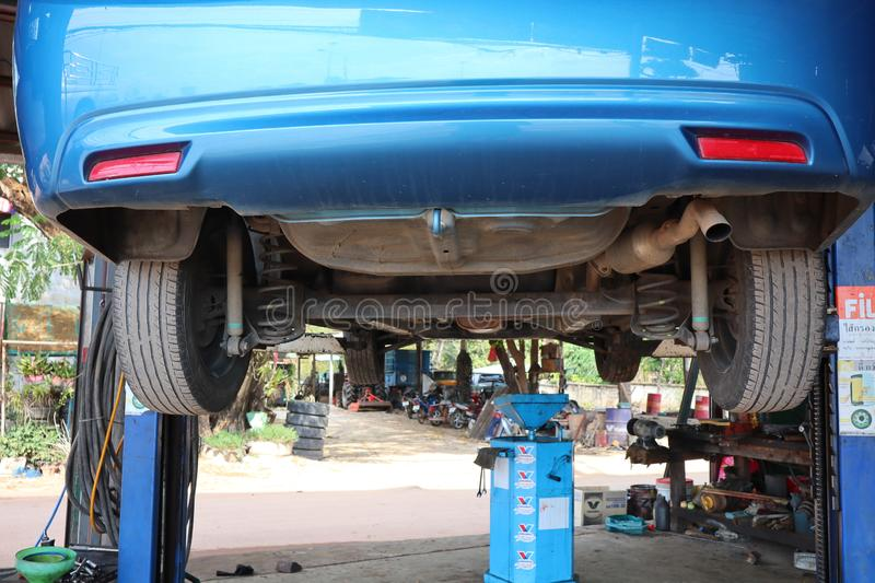 Uttaradit, Thailand, May 4, 2019, system check  The bottom of the car  Oil change  Car care, garage, repairman stock photography