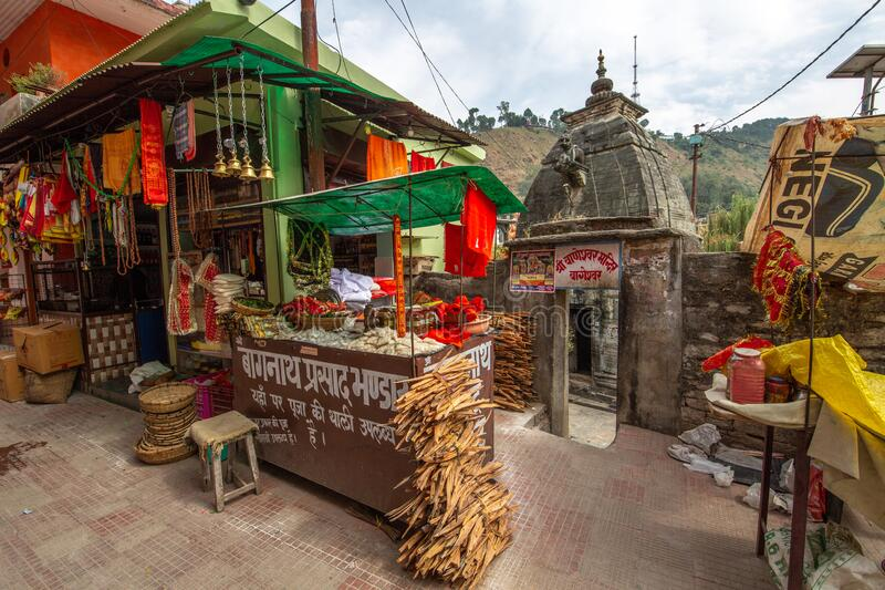Ancient Hindu stone temple with street shops selling religious items at Bageshwar Uttarakhand India. Uttarakhand, India, October 10,2018: Ancient stone Hindu stock photo