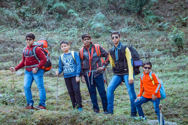 Uttarakhand, India, 1 October, 2018 - Hiking Kids. Youngsters out to explore the world around them. Walk along narrow forest royalty free stock photos