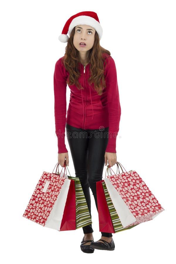 Uttråkad jul som shoppar kvinnan arkivfoton