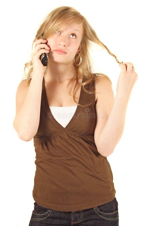 uttråkad mobiltelefonkvinna royaltyfria bilder