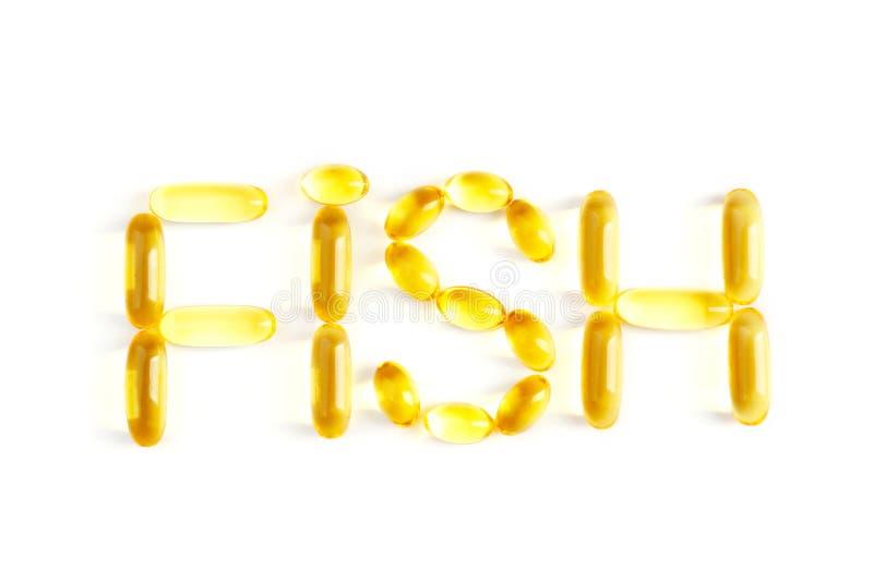 Uttrycka FISKEN som göras av kapslar för olja för torsklever, isolerat på vit arkivfoto