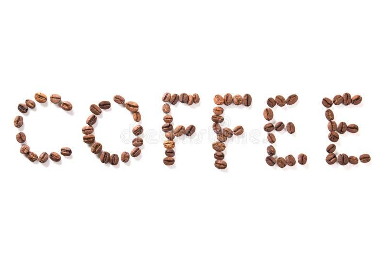 Uttrycka kaffe, grillade bönor över vit bakgrund royaltyfria foton