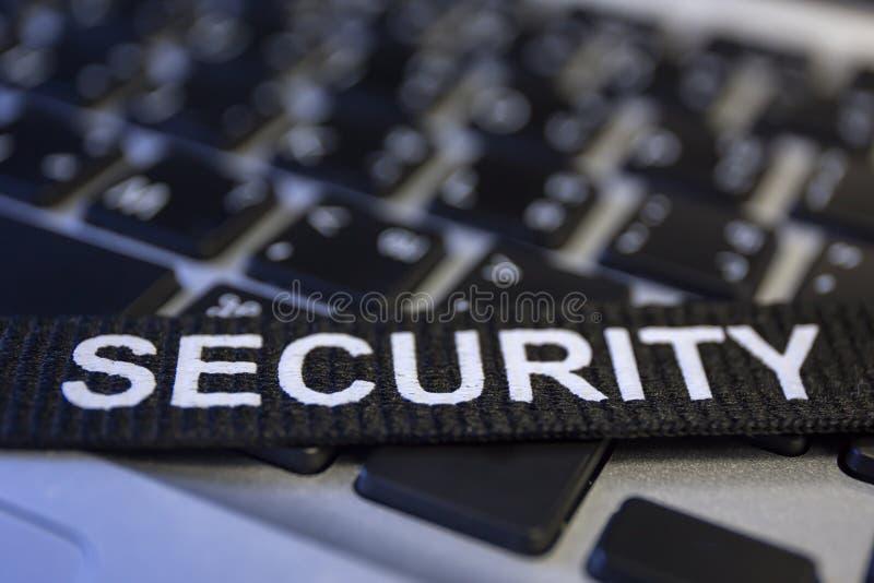Uttrycka säkerhet på för cyberbrott för labtop tangentbordet symboliserad protecti fotografering för bildbyråer