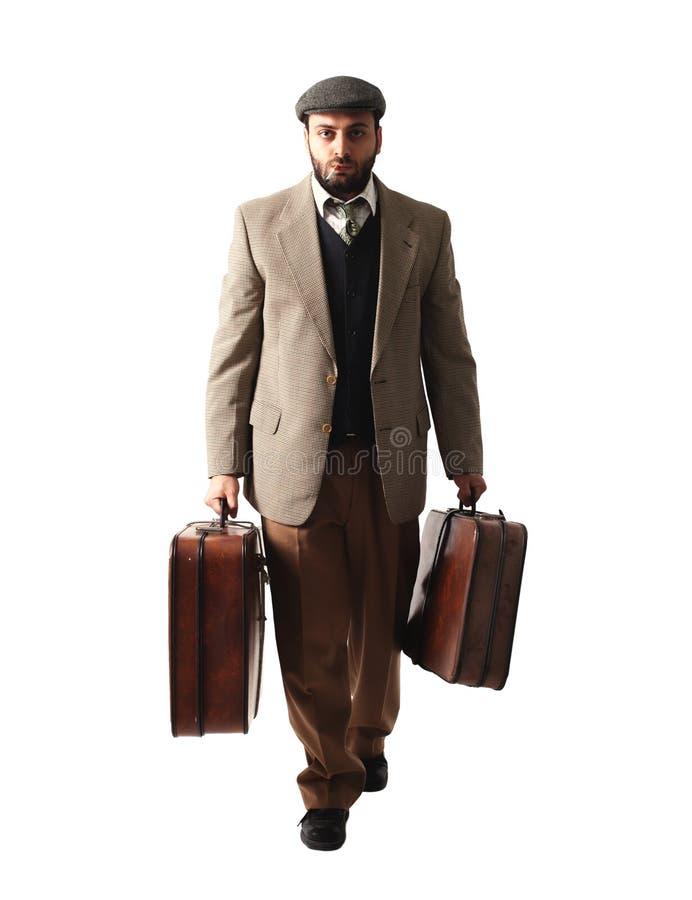 Utvandrareman med resväskorna arkivbild