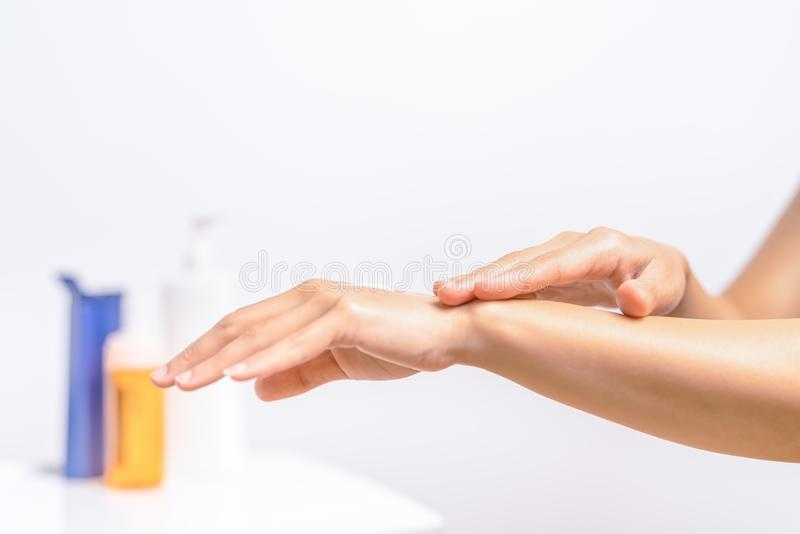 UV Protection Body Lotion Skin Care Apply. women hands holding UV protection body cream bottle. Beauty And Body Care Concept royalty free stock image