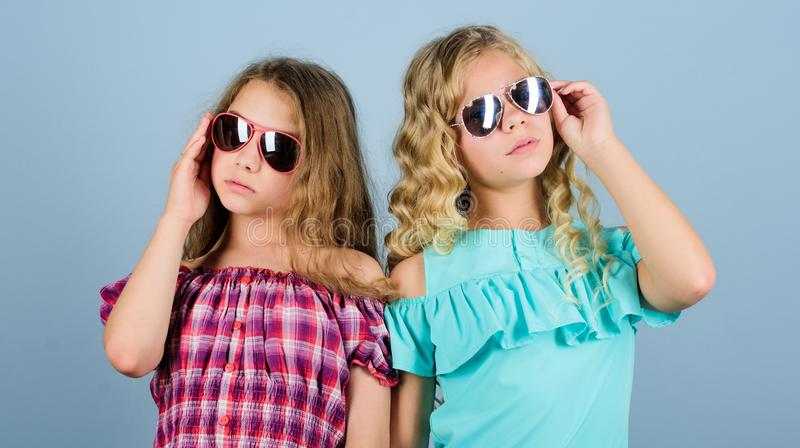 UV protection. Eye health. Buy proper sunglasses. Optics store. Cute small kids fashion girls. Girls long curly hair stock photos