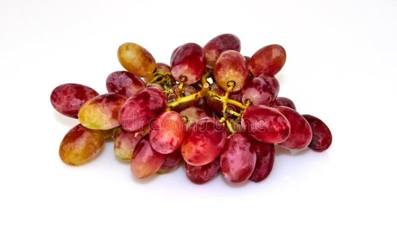 Uvas amarelas vermelhas isoladas imagem de stock