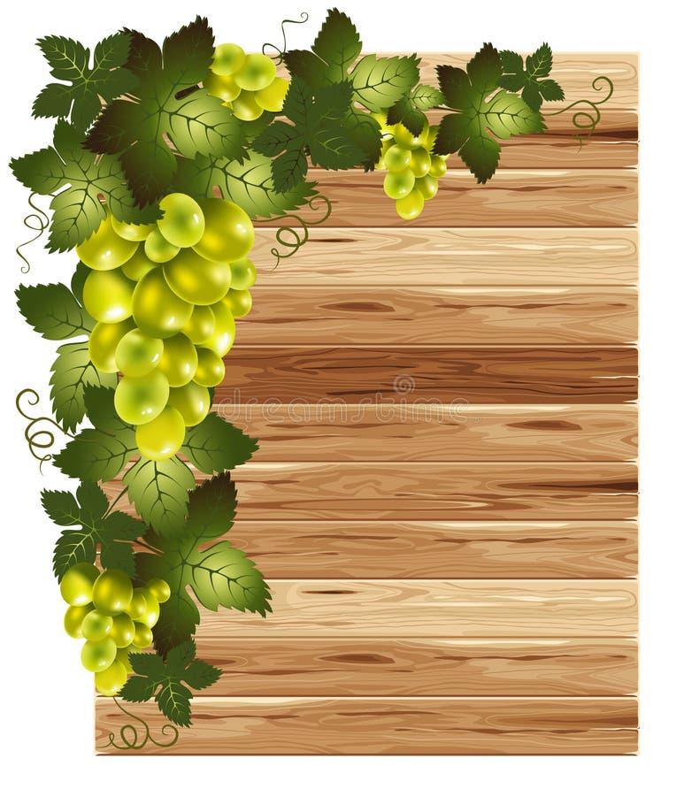 Uvas brancas em um fundo de madeira ilustração stock
