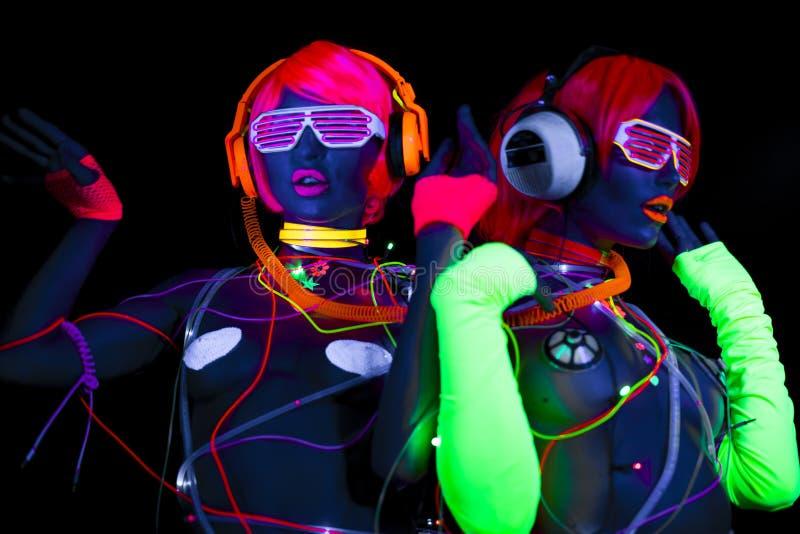 UVsexy Neondisco des Glühens weibliche Cyberpuppe stockfoto