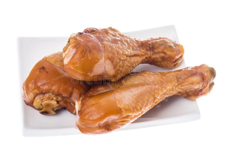 Uwędzeni kurczaków kawałki na białym tle zdjęcie stock