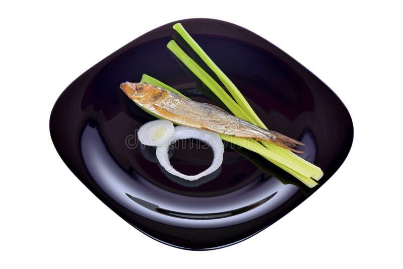 Uwędzona ryba i cebula zdjęcia royalty free
