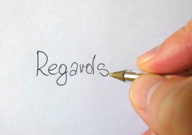 Uwzględnienia Pisze ręce obraz stock