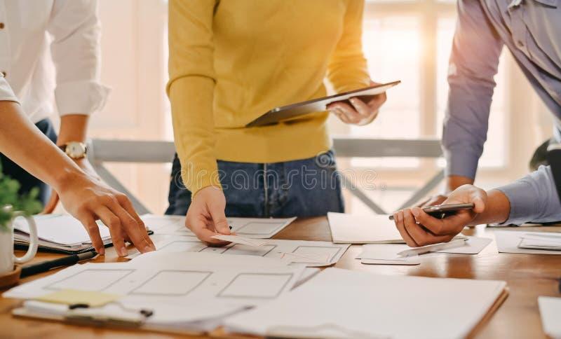 UX UI concept, Team of Website designer Creative planning application development draft sketch drawing template layout.  stock photos