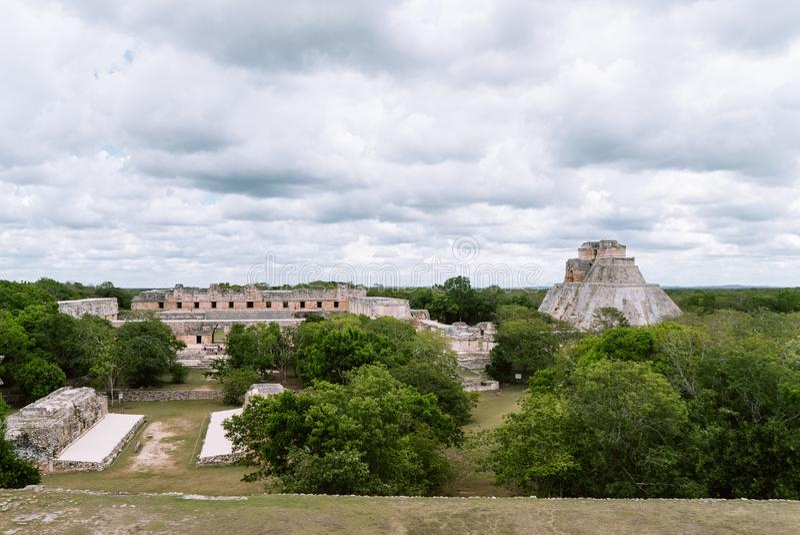 The ruined Nunnery Quadrangle and The Pyramid of Magician, Uxmal, Yucata, Mexico. Uxmal, ruined ancient Maya city in Yucatan state, Mexico, designated a World royalty free stock photos