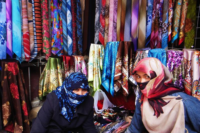 Uyghur girls at market stock photo