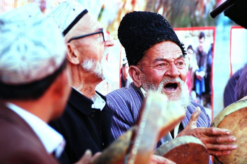 Uyghur old men singing with drums stock image