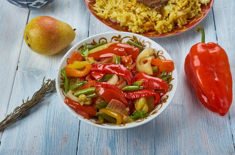 Uyghur Suoman gush siz. Suoman gush siz, delicious dish of vegetables, peppers. Uyghur cuisine, Asia Traditional assorted dishes, Top view stock photos