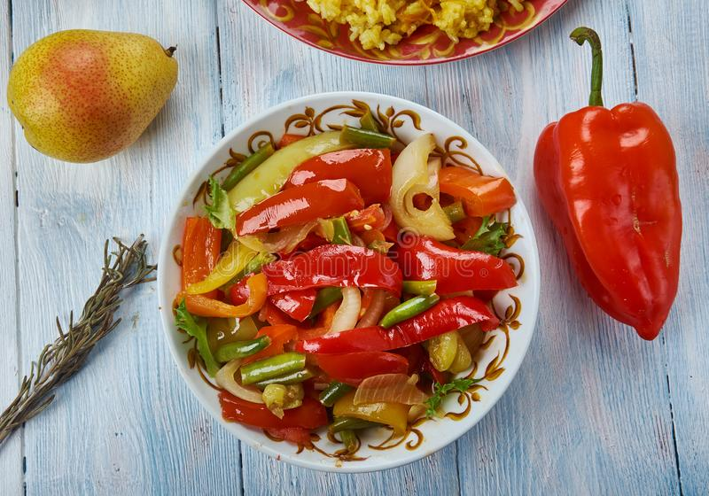 Uyghur Suoman gush siz. Suoman gush siz, delicious dish of vegetables, peppers. Uyghur cuisine, Asia Traditional assorted dishes, Top view royalty free stock image
