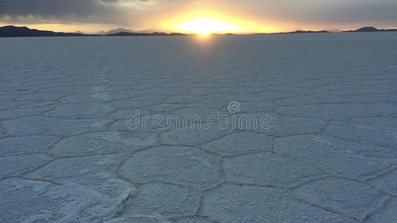 Uyuni salt flats at sunset, southern Bolivia. The amazing bolivian slat flats at sunset showing the unique details of the salt formations close up stock images