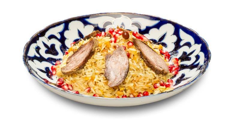 uzbek pilaf тарелки национальный стоковая фотография rf