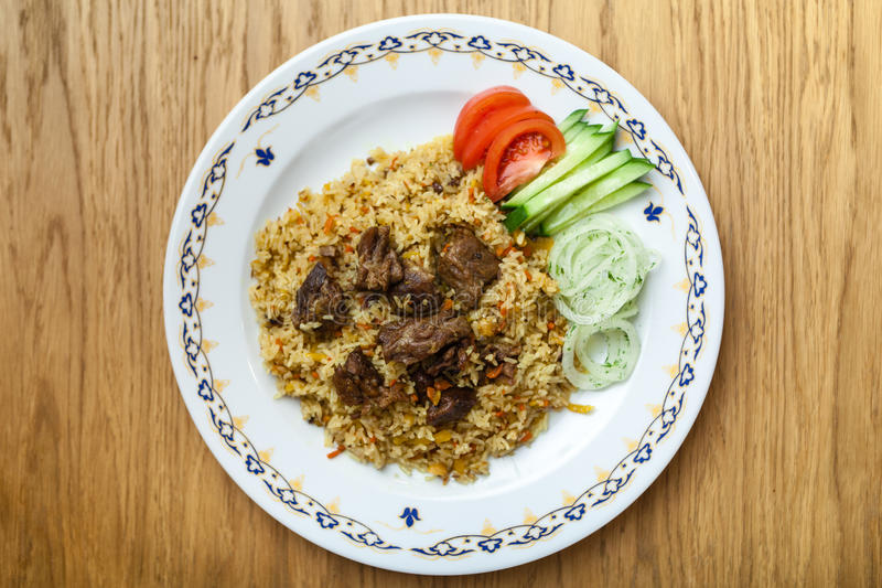 Uzbek pilaf with beef stock photos