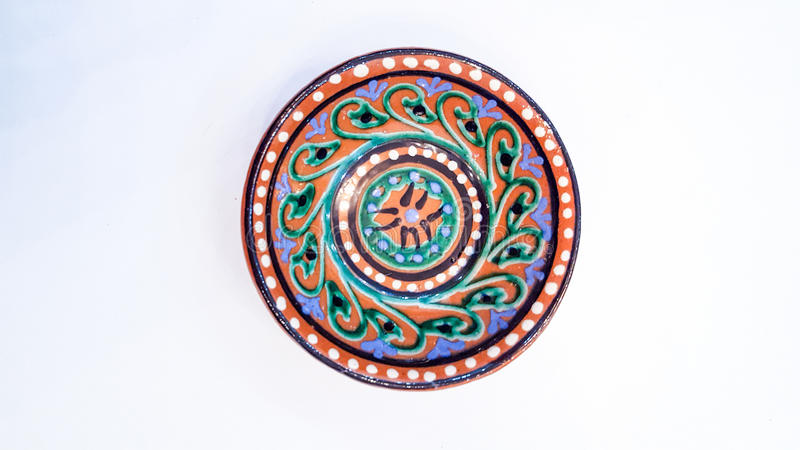Uzbek pottery - bowl made by the ceramics of Gijduvan, which lies near Bukhara, they emphasize the warm Golden and brown colors royalty free stock photography